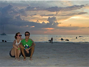 couple sitting on a beach in Malaysia