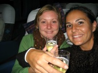 women drinking chanpagne on overnight bus argentina