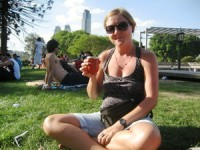 Ceri having a drink in a park in buenos aires