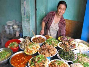 local woman serving food vietnam