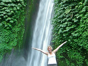 woman standing by waterfall