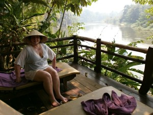customer sitting along river in thailand