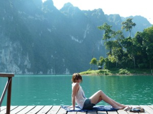 staff member hannah sitting at racha praba lake in thailand