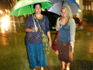 girls with umbrellas in bangkok thailand