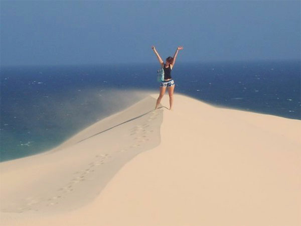 girl standing on sand dune in south africa