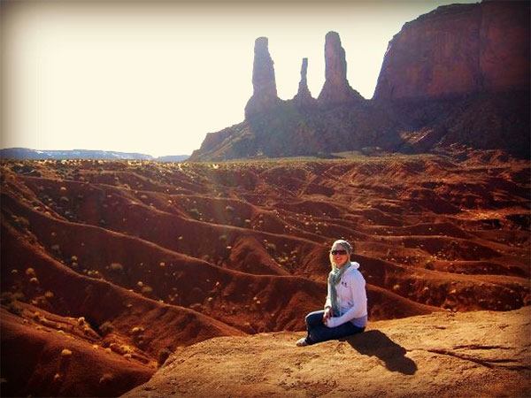 girl sitting in monument valley