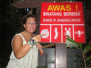 girl in front of sign in malaysia