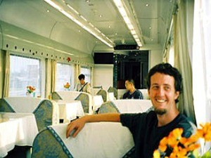 Man sitting in the restaurant of a train