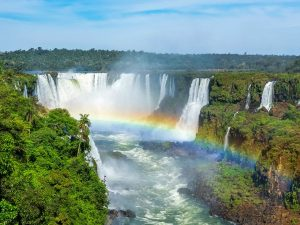 waterfalls and rainbow at iguazu falls
