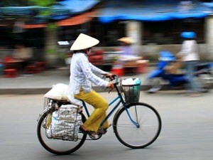 local riding bicycle in vietnam