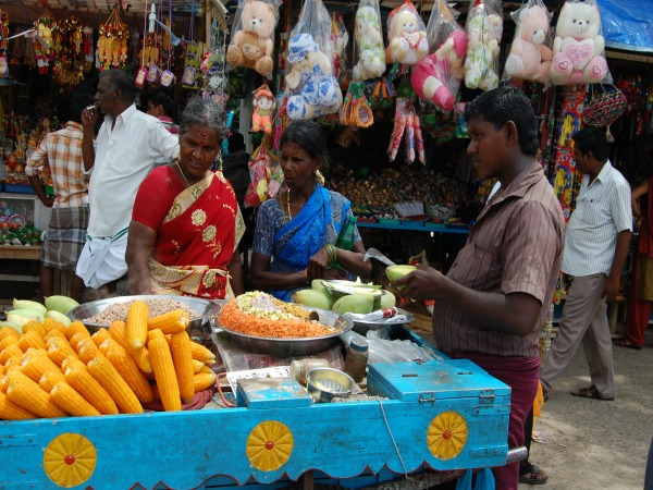 Locals selling corn at market stall India