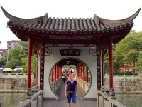 woman standing in front of temple in china