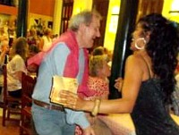 man dancing with local musicians in cuba