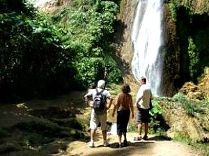 hikers at base of waterfall in cuba