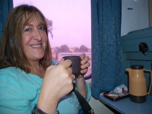 woman drinking tea on the train in India