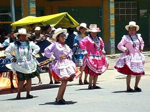 women dancing in peru