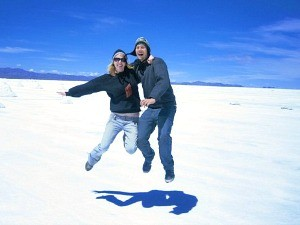 couple jumping at salt flats in bolivia