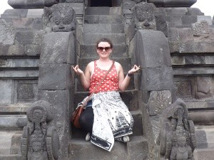 Woman sitting on Indonesia statue