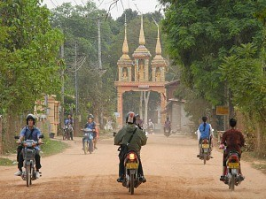 scooters by temple in laos