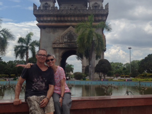 customers in front of a historical monument in cambodia