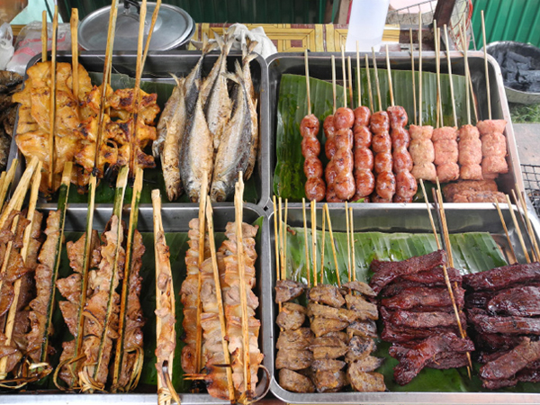 Raw food on a stick in a market in Chiang Mai, Thailand