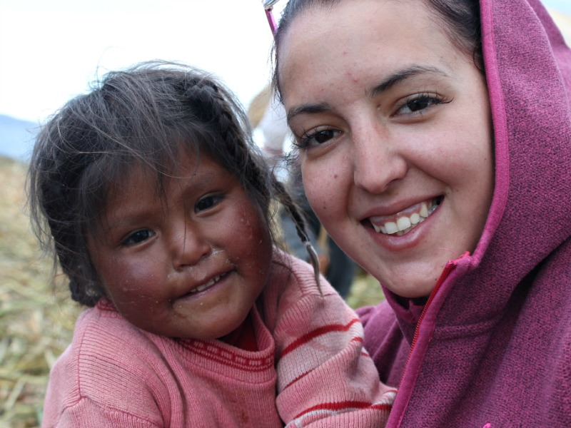 woman smiling with local girl in bolivia
