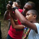 Young boy talking pictures with guide in Malaysia