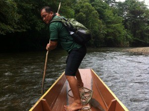 local man rowing boat borneo