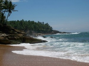 crashing waves on beach Kovalam in india