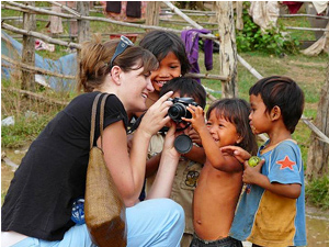 Customer showing local children a photograph on her digital camera