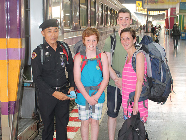 Family in front of train in Thailand