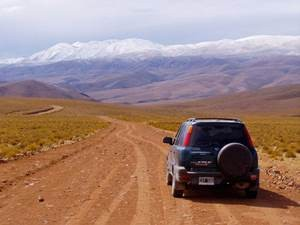 Car driving through the mountains in Salta, Argentina