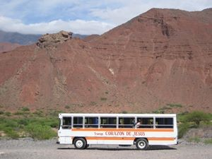 Bus driving past mountains in Argentina