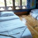 homestay beds on floor in chimi lhakhang