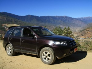 Black 4x4 car used by Rickshaw Travel to transport customers in Bhutan