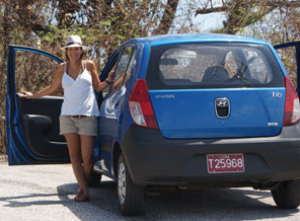 woman standing with hire car in Argentina