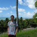 Travel specialist Ross in front of palm tree in Brazil