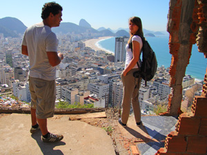 People stood on mountain with views of Rio, Brazil