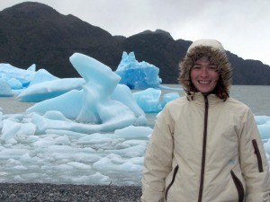 Woman standing in front of glacier