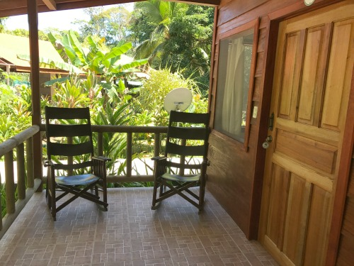 Two outdoor chairs on balcony in Evergreen lodge Veranda accommodation in Tortuguero