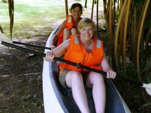 Mother and daughter canoeing in Costa Rica on holiday