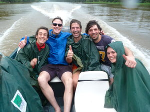 Soaking wet tourists wrapped in towels on a boat excursion in Tortuguero