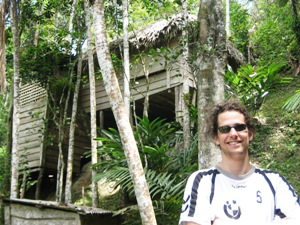 Customer in front of a treehouse