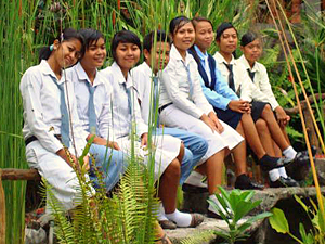 school girls sitting on wall