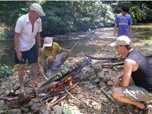 Building a campfire in Endua Rompin