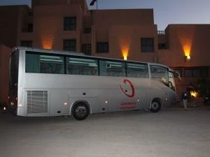 Coach parked outside building in Morocco