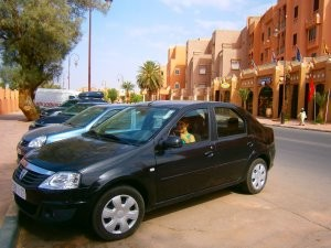 Woman sitting in hire car in Ouarzazate in Morocco