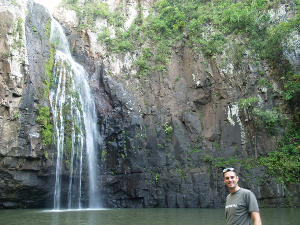 Man standing in front of a waterfall and lagoon in Nicaragua