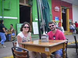 Couple sitty at cafe table in granada
