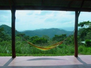 Hammock swinging between two pillars with mountain background in Nicaragua